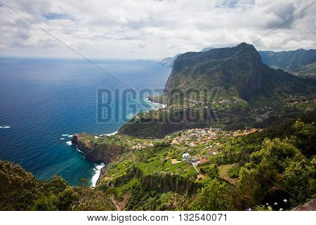 Coastal view in Madeira with settlement at the foot of the mountain