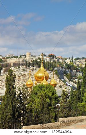 Golden domes of the Church of St. Mary Magdalene. Mount of Olives in Jerusalem