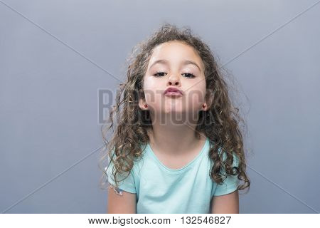 Little Brunette Girl Making Air Kiss