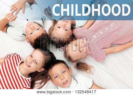 Top view of children lying on floor.Concept of careless childhood