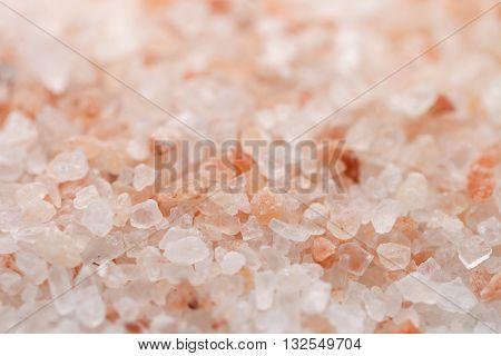 Himalaya pink salt background. Himalayan salt pile. Pink crystal salt. Close up Himalayan salt - pink and orange coarse crystals.