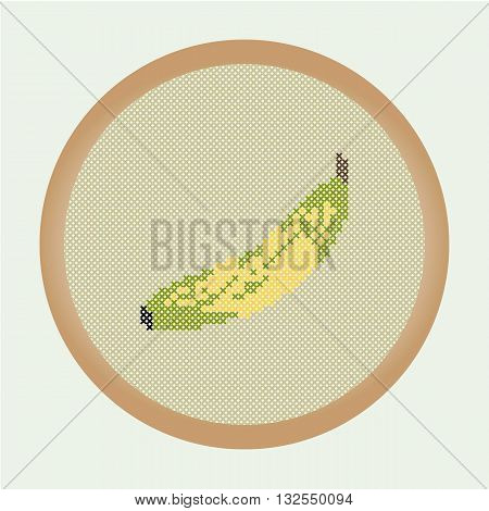 Embroidery banana. Vector illustration: the banana which is cross stitched in a round frame