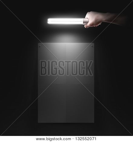 Hand holding lamp near the wall with blank poster mockup, isolated. Idea, night club event poster party design preview presentation. Wall mock up in light. Person hold torch in hands illuminate.
