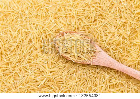 Raw vermicelli pasta background. Pasta Vermicelli texture background. Traditional Italian food.