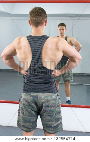 Back View Of Confident And Masculine Man At The Gym