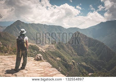 Backpacker Standing In Contemplation On The Inca Trail Above Machu Picchu, The Most Visited Travel D