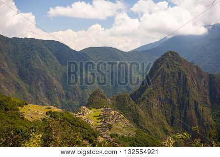 Wide Angle Panoramic View Of Machu Picchu, Illuminated By Afternoon Sunlight, And The Majestic Uruba
