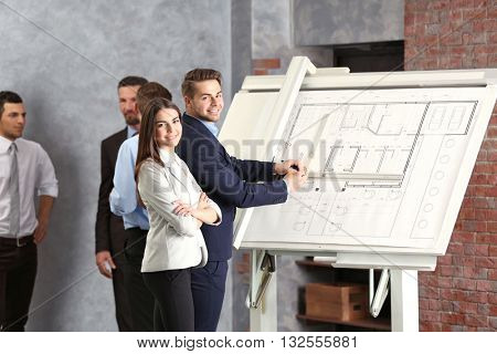 Engineers working with panel board indoors