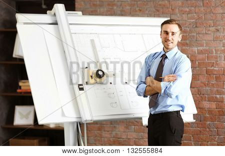 Engineer working with panel board indoors