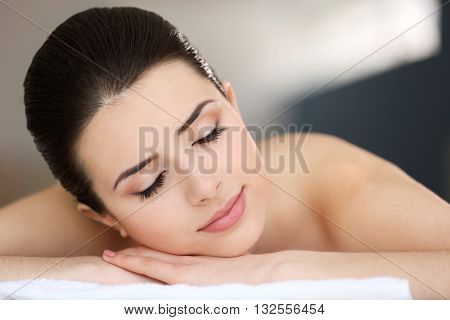 Young woman relaxing in spa center