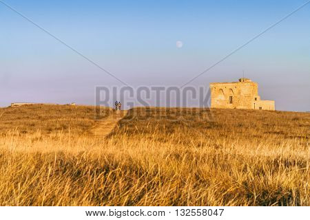 Summer landscape: a nature reserve of Torre Guaceto.BRINDISI (Apulia)-ITALY-Mediterranean maquis: a nature sanctuary between the land and the sea.Bike ride at the watchtower.