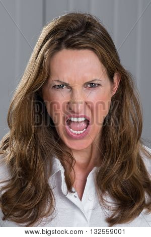 Portrait Photo Of Angry Mature Woman Screaming