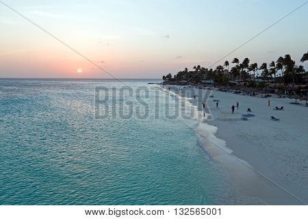 Aerial from Manchebo beach on Aruba island in the Caribbean Sea at sunset