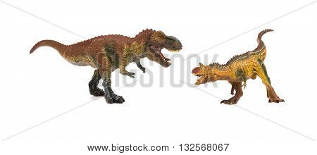 tyrannosaurus and carnotaurus on a white background