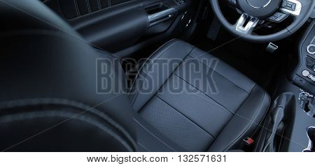 Black leather on seats in car interior stock photo