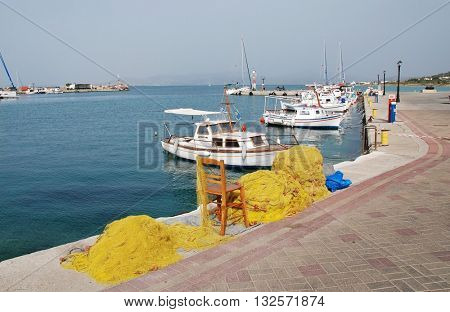 AGISTRI, GREECE - MAY 12, 2016: Fishing nets and boats in the harbour at Milos on the Greek island of Agistri. The small Saronic island is just under an hour from Piraeus harbour in Athens.