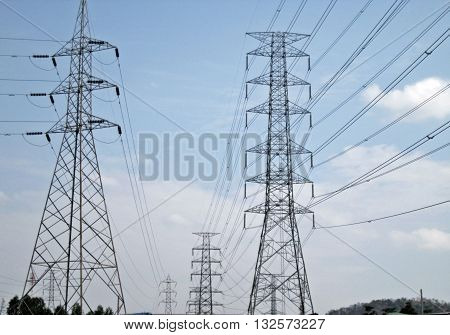 High voltage electric wires on sky background