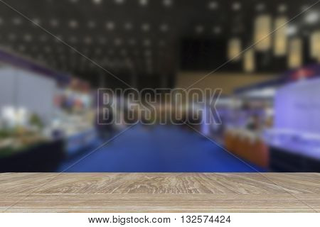 wooden table for display or montage your product with blur background of people shopping in fair