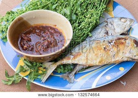 neem leaf food plate taste bitter sauce with fried mackerel