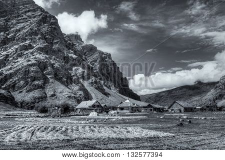 Sceneic view of Drass village with blue cloudy sky background Kargil Ladakh Jammu and Kashmir India Nice Black and white image depicting beautiful rural hilly Indian view