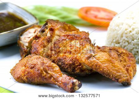 Grilled chicken legs with chips and vegetables,The food of a luxury hotel.