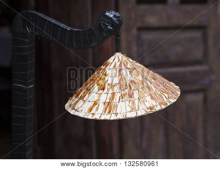 Close up of a conical hat hanging as decoration in Hoi An ancient town, Vietnam