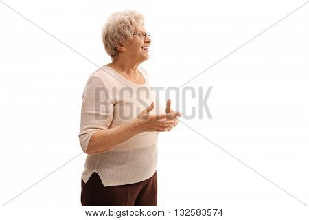 Elderly lady talking to someone and explaining something isolated on white background