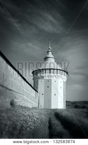 Watch tower of Spaso-Prilutsky Monastery in the Vologda city Russia. Castle defense wall. Black and white image