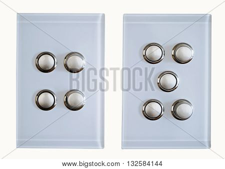 two modern light switches on a white background