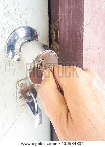 Open door with keys key in keyhole