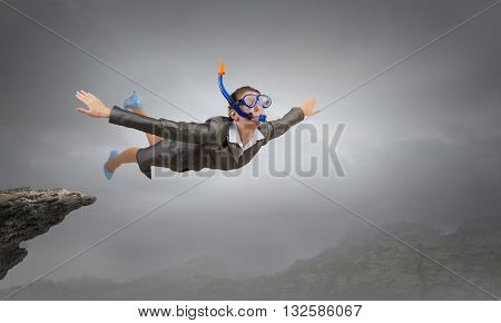 Businesswoman diver in free fall