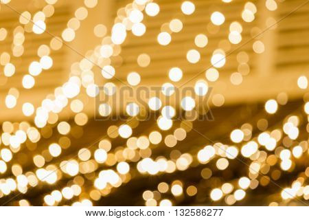 Blurry blurred focus abstract golden bokeh . Defocused christmas with lights and Texture background.