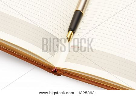 Gold Pen On Diary