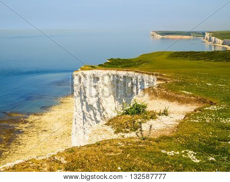 Forces of the English Channel destroy white chalk cliffs. East Sussex, England