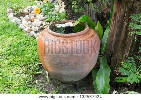 earthen jar in the garden earthen water jar garden propsAncient Thai Jars for storage rainwater
