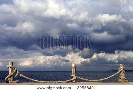 Seafront and cloudy storm sky in autumn. Turkey Erdek coast of Marmara.