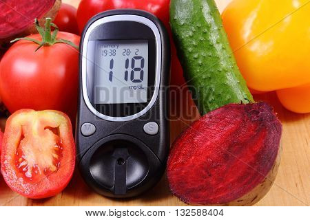 Fresh ripe vetables and glucose meter on wooden table diabetes healthy lifestyle and nutrition result of measurement of sugar