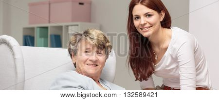 Smiling granddaughter caring about her weak grandmother