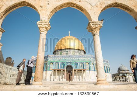 Jerusalem Israel - November 3 2015: Tourists next to Dome of the Rock mosque on Temple Mount