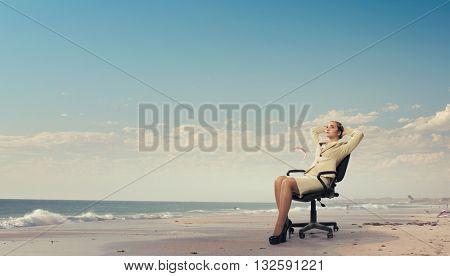 Businesswoman having rest in chair