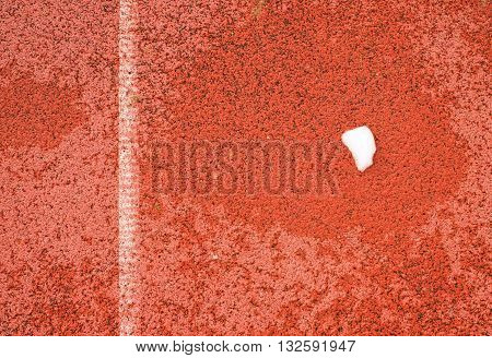 Snow On Ground.  White Lines And Texture Of Running Racetrack, Red Racetrack,  In Outdoor Stadium