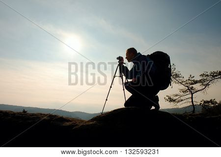Amateur Photographer Takes Photos With Mirror Camera On Neck.  Dreamy Foggy Landscape
