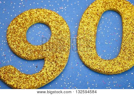 Number ninety yellow color over a blue background. Anniversary. Horizontal