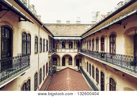 Courtyard of old stylish building in historic centre of Budapest Hungary. Architectural theme. Cultural heritage. Possibility of accommodation. Old house. Retro photo filter.