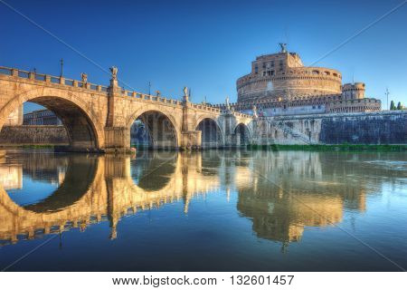 Saint Angel Castle (Castel Sant Angelo) and bridge over the Tiber river in Rome, Italy