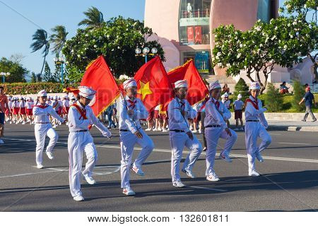 NHA TRANG VIETNAM - MAY 31: Pioneer children march on the parade at the end of the school year in Nha Trang Vietnam on May 31 2016.