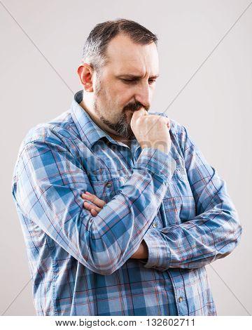 Studio shot portrait of worried pensive man