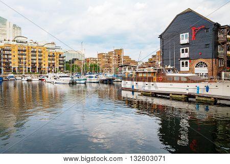 Yachts moored in St Katharine's Dock. London England UK