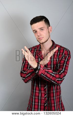 Serious Young Hipster Man Makes An X Shape