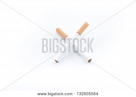 Cigarette with brown filter on white background